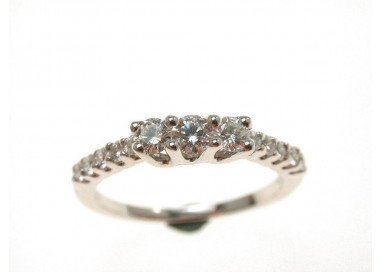 Trilogy ring surrounded