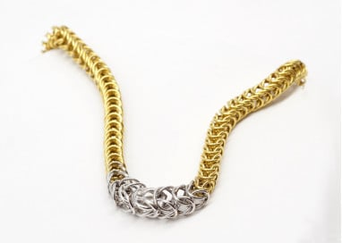 Tubolar chain with circles and invisible clasp