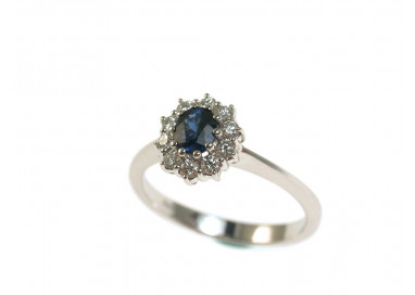 Ring with Oval Blue Sapphire 5x4 with diamonds