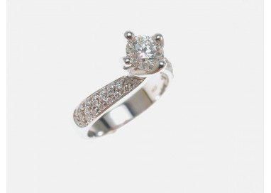 Surrounded Solitaire Ring